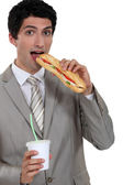 Businessman having lunch — Stock Photo