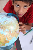 Schoolboy interested in geography — Stock Photo