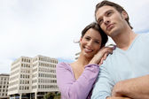 Man and woman in front of an office block — Stock Photo