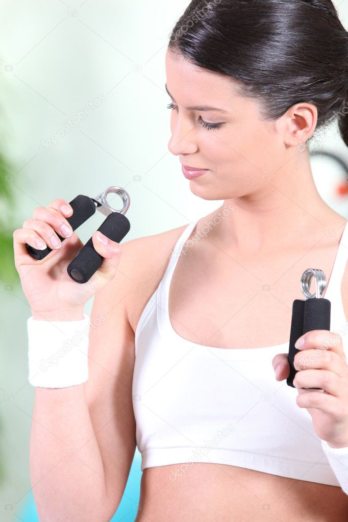 Brunette working out in gym — Stock Photo #8400181