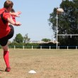 Stock Photo: Rugby player kicking ball