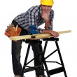Carpenter leaning on work-bench — Stock Photo