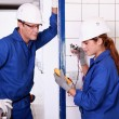 Stock Photo: Electricians taking measurements