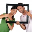 Stock Photo: Couple holding empty art frame