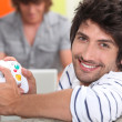 Stock Photo: Man holding video game control pad