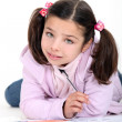 Little girl doing schoolwork — Stockfoto
