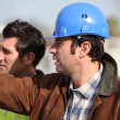 Construction supervisor and assistant observing — Stock Photo