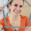 Woman using measuring device — Stock Photo