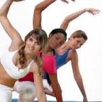 Three women in gym class — Stock Photo
