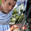 Stock Photo: Mrepairing motorcycle