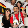 A group of friends supporting the German football team - Stock Photo