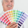Man holding paint swatch — Stock Photo