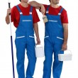 Painters standing on white background — Stock Photo