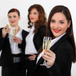 Stock Photo: Young women in smart suit with glasses of champagne