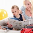 Womreading book to her son — Stock Photo #8412063