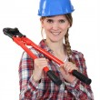 Woman with a pair of boltcutters - Stock Photo