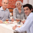 Grandparents and grandson eating at restaurant — Stock Photo #8413099