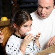 Man with little girl having breakfast — Stock Photo #8414156