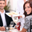 Couple eating in a restaurant — Stock Photo #8414737