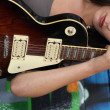 Stock Photo: Closeup of female guitarist