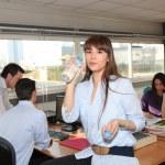 Woman having break in office — Stock Photo