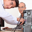 Computer technician repairing PC — Stock Photo #8417311