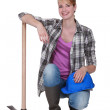 Pretty woman with a pickaxe — Stock Photo #8417598