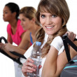 Three women in the gym — Stock Photo