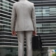Stock Photo: Businessmwith gray suit, back view