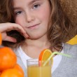 Little girl drinking orange juice — Stock Photo #8419906