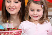 Young girl on her 4th birthday — Stock Photo