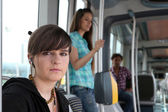 Young woman on a tram — Stock Photo