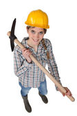 Smiling woman with a pickaxe — Stock Photo