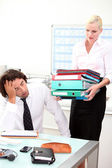 Overworked businessman and his assistant — Stock Photo