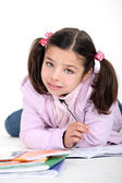 Little girl doing schoolwork — Foto Stock
