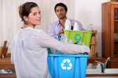 Man and woman preparing to recycle plastic bottles — Stock Photo