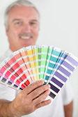 Man holding paint swatch — Stock Photo