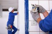 Worker installing a plug — Стоковое фото