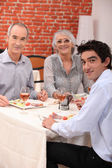 Grandparents and grandson eating at restaurant — Stock Photo