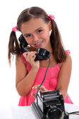 Girl with vintage phone — Stock Photo
