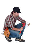 Plumber using a pipe wrench — Stock Photo