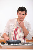 Man cooking alone on kitchen — Stock Photo