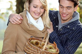 Couple collecting chestnuts — Stock Photo