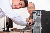 Computer technician repairing PC — Stock Photo
