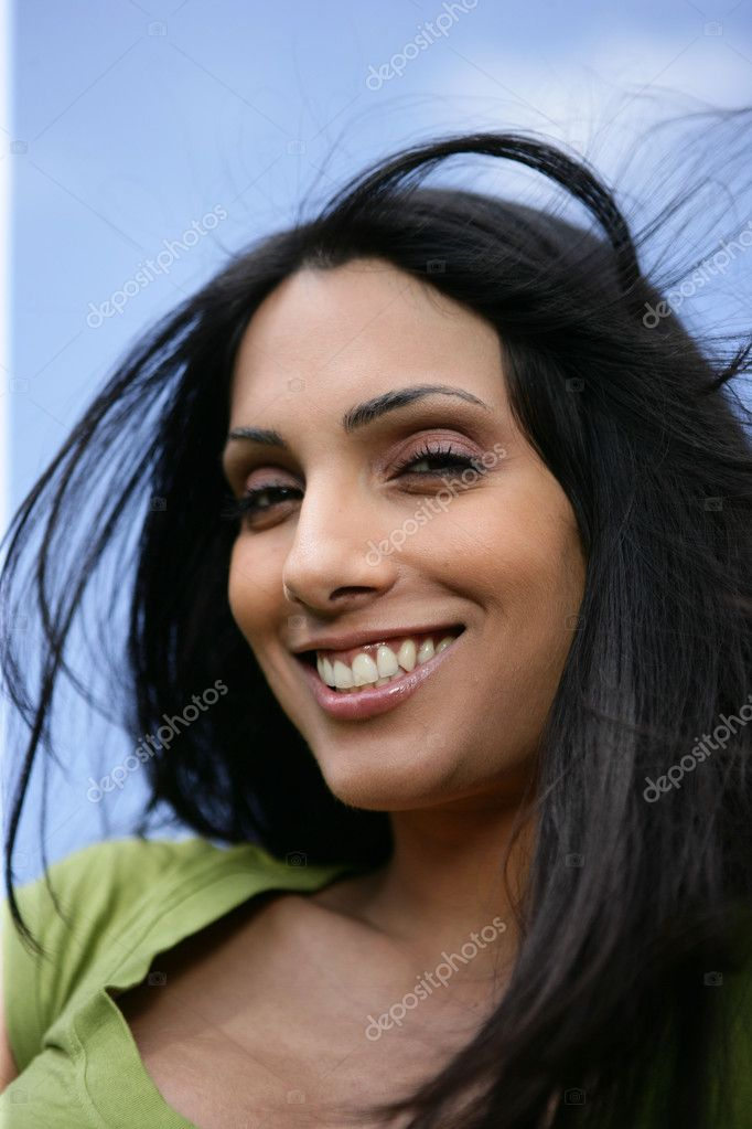 Portrait of beautiful dark haired woman stock image