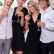 Two young couples drinking champagne — Stock Photo #8420492