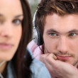 Man with headphones beholding his belle — Stock Photo