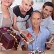 Family celebrating a birthday together — Stock Photo #8420672