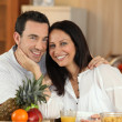 Stock Photo: Couple shining with happiness at breakfast