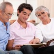 Grandparents spending time with their grandson — Stockfoto